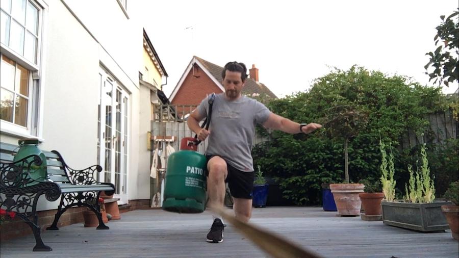 Dr Craig Sheridan exercising on his patio