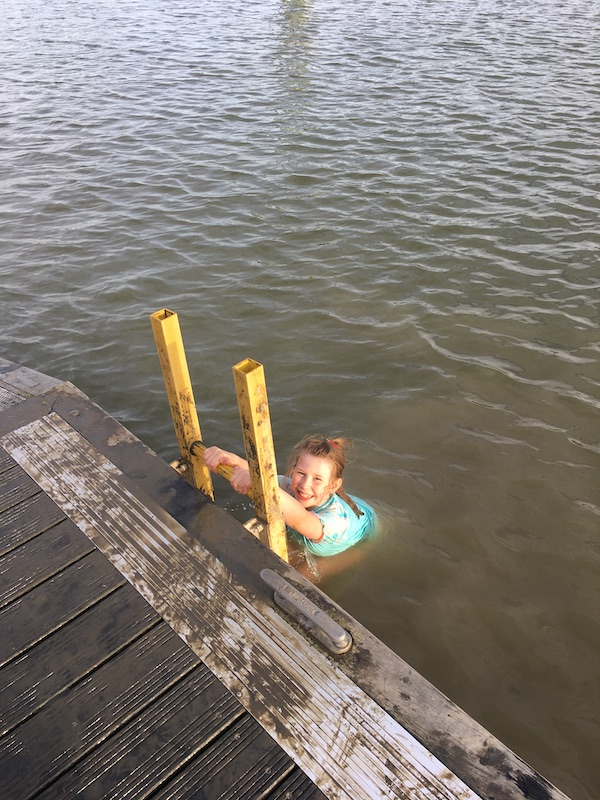 child in water swimming