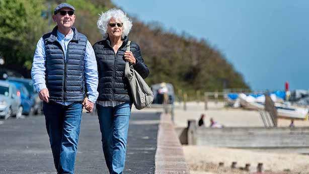 Couple walking along beachfront