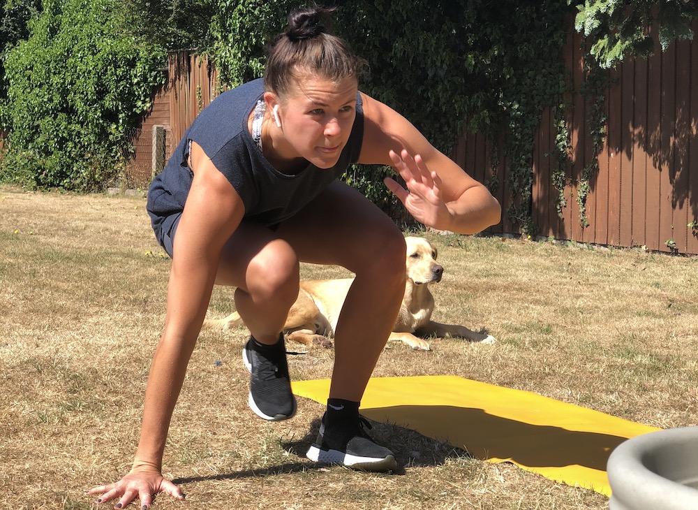 Millie exercising on grass
