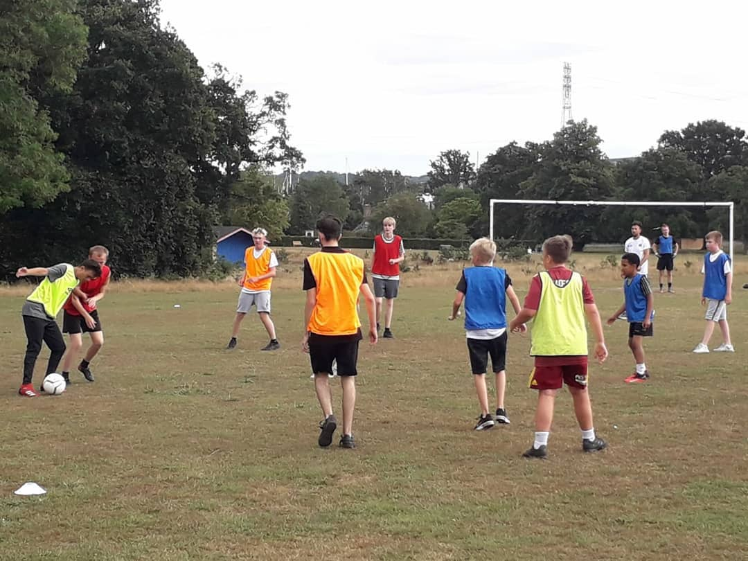 group of young people playing football