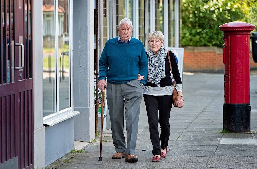Older couple walking to post office