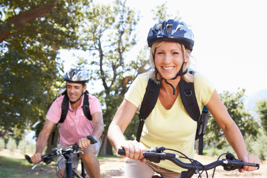 Couple cycling and smiling