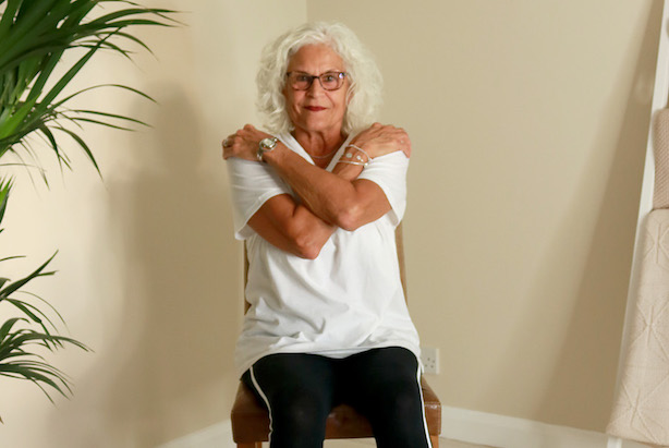 LADY DOING ARMCHAIR EXERCISE