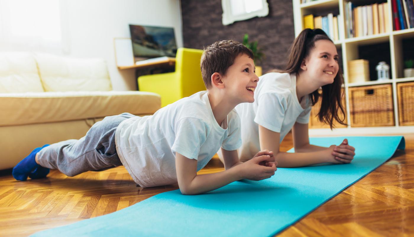 two children exercising on floor