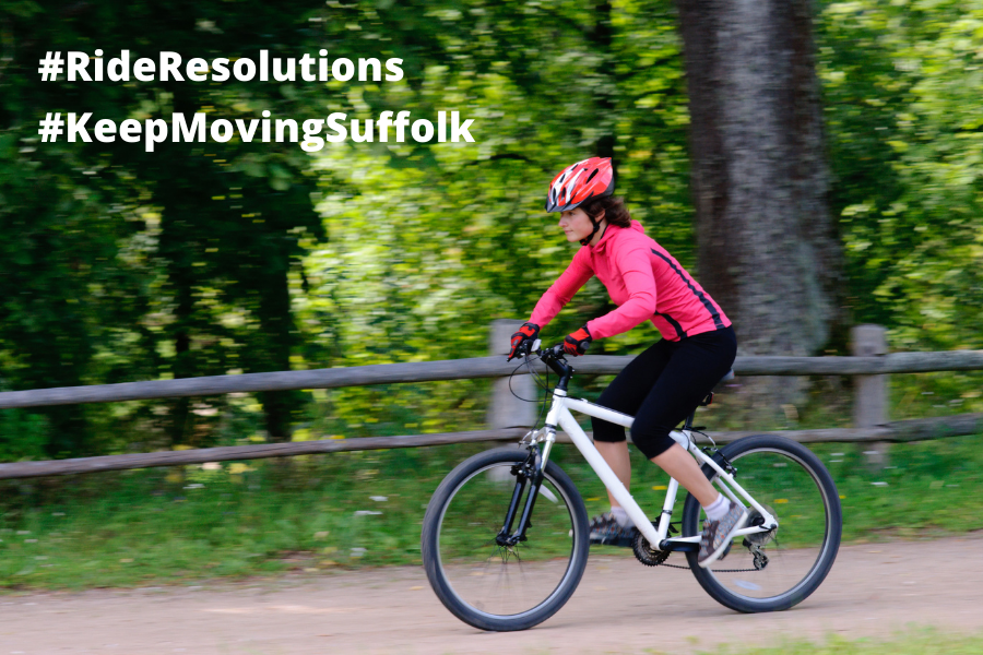 Lady Cycling with hashtags Ride Resolutions and Keep Moving Suffolk