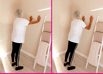 lady doing walll press exercise