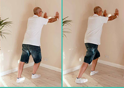 Man doing calf stretch exercises