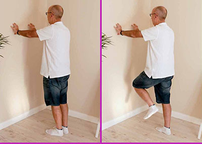 MAN doing one leg stand exercise with eyes closed