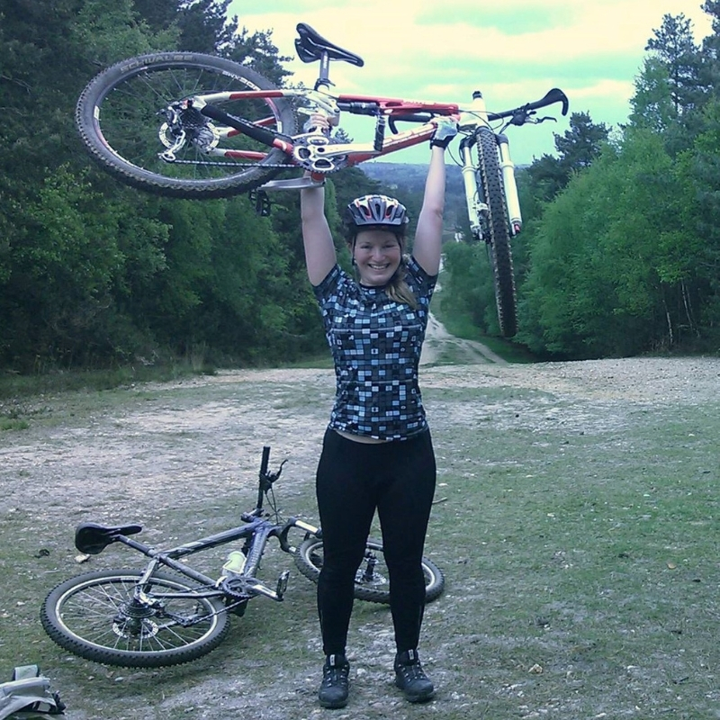 gayle with bike above head