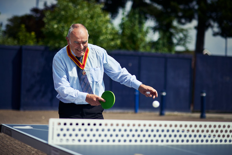 Cllr Newman playing table tennis