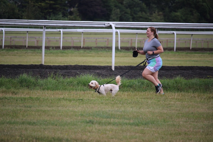 lady running with dog