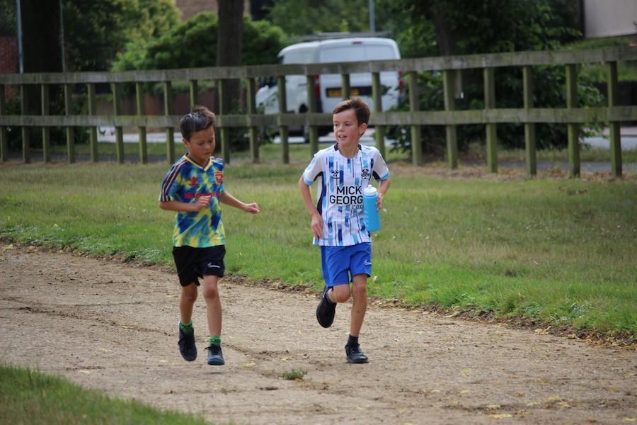 boys running in run newmarket