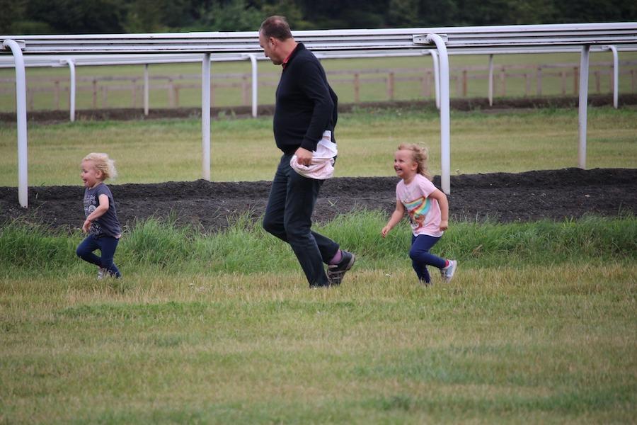 man and small children running